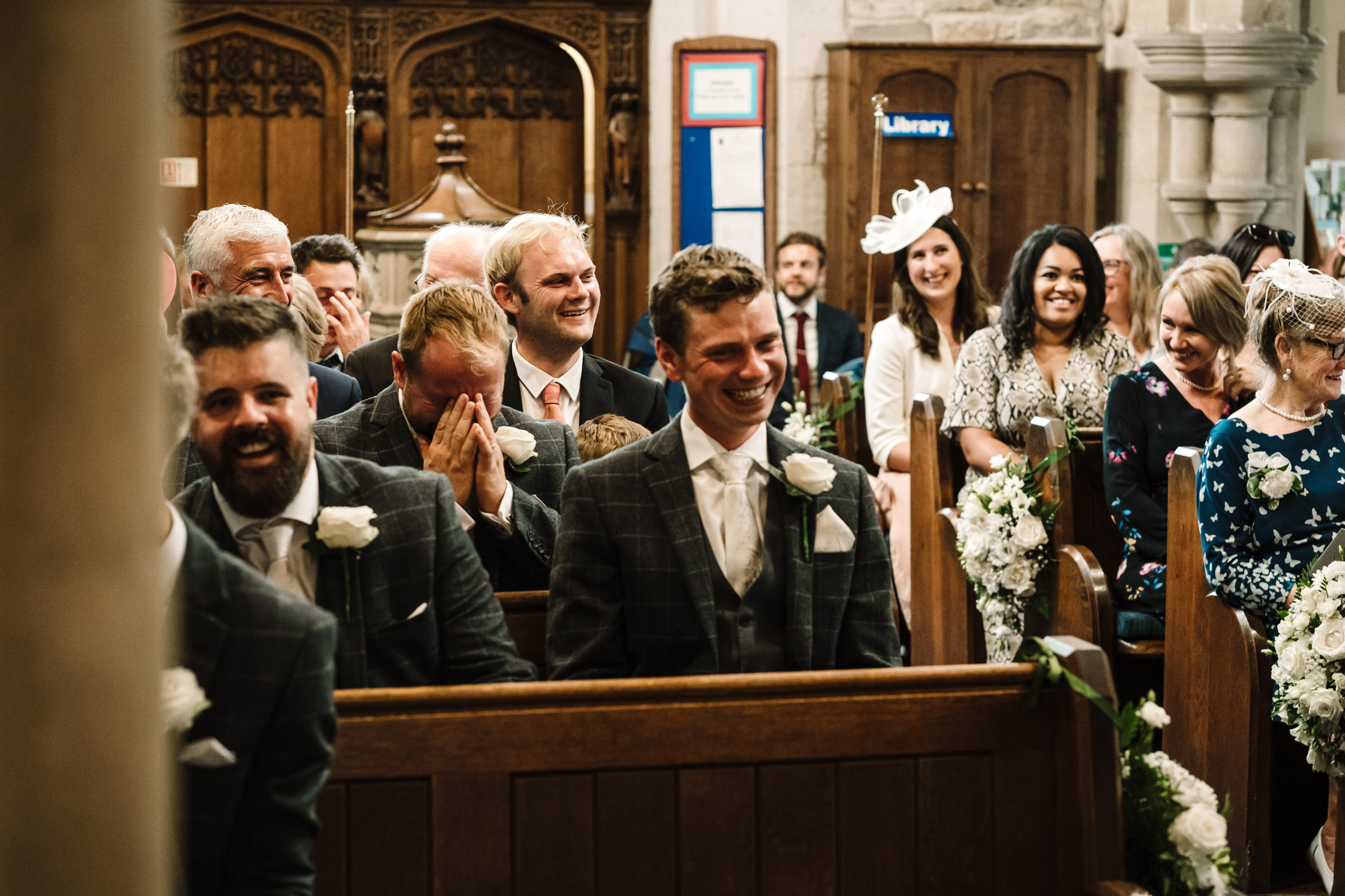 guests laughing during church wedding
