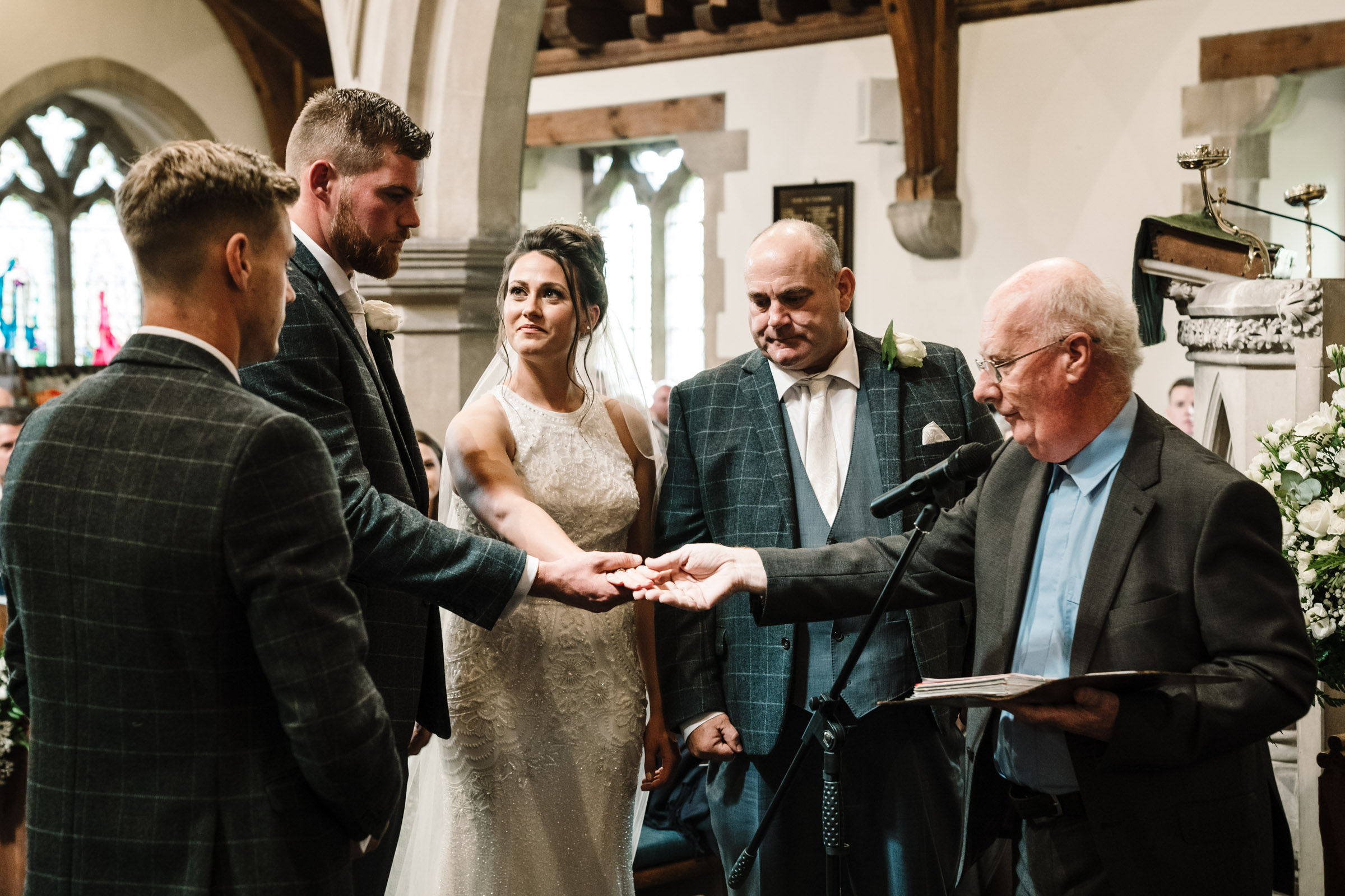 Father of the bride giving daughters hand in marriage