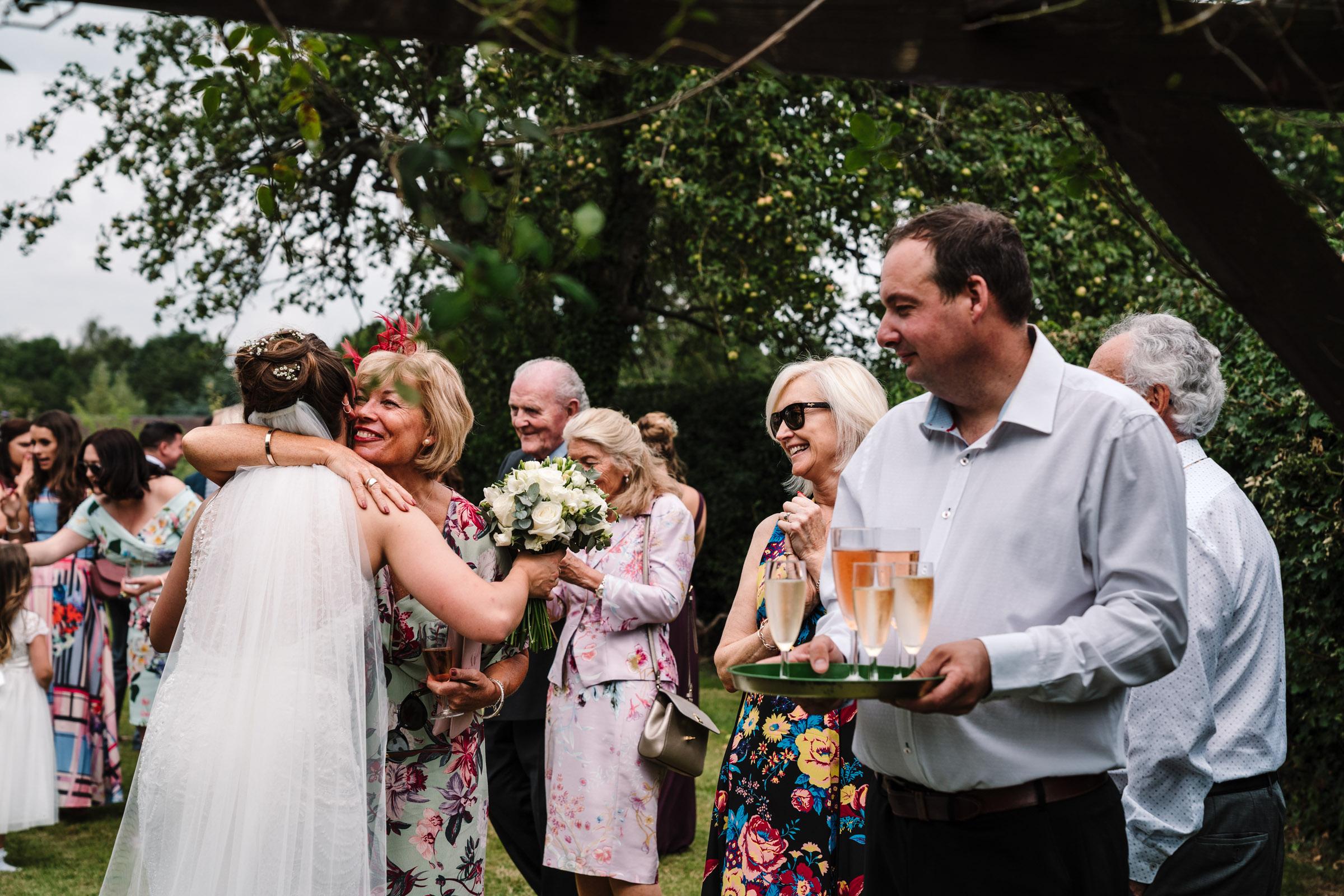 garden drinks reception at tipi wedding