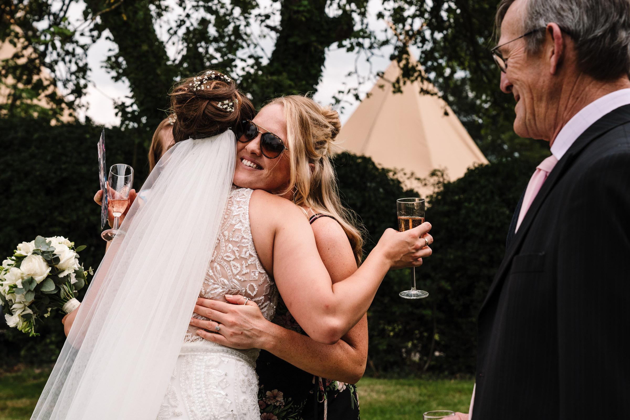 guests congratulating bride at tipi wedding reception