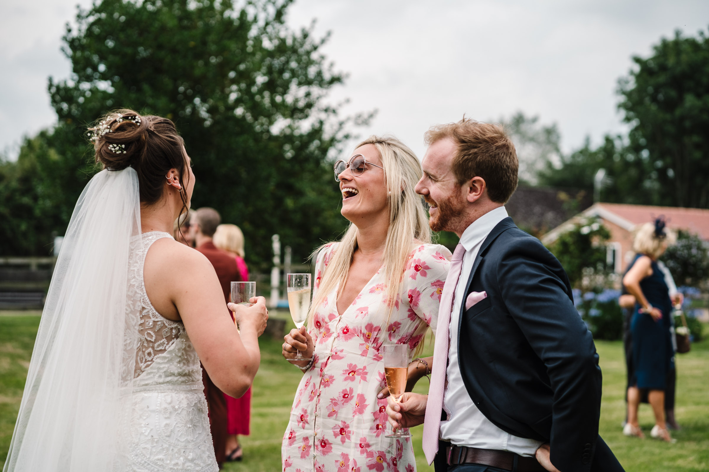 guests laughing with bride at tipi wedding