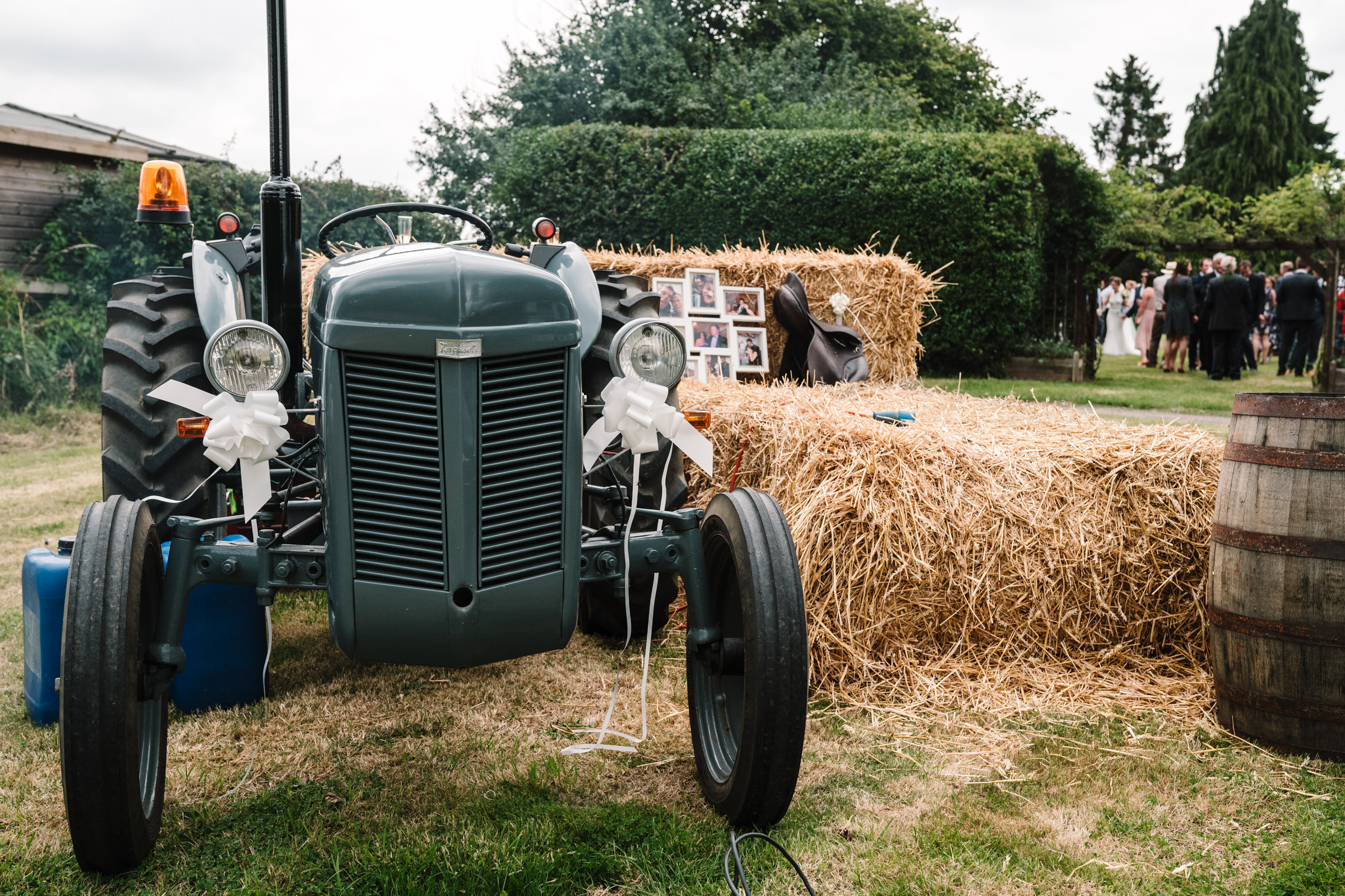 attractor and hay bales, tipi wedding details
